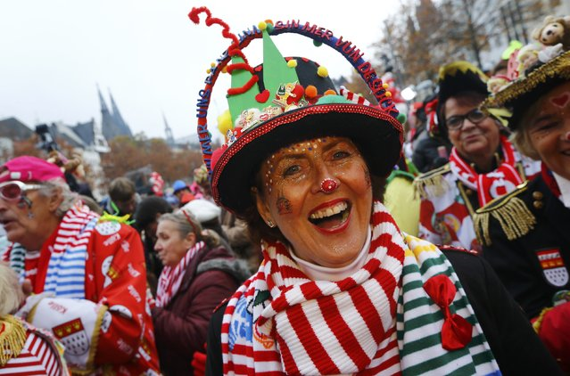 Revellers celebrate the start of the carnival season, a season of controlled raucous fun that reaches a climax during the days before Ash Wednesday and the start of Lent, at 11.11 am in Cologne, Germany, November 11, 2016. (Photo by Wolfgang Rattay/Reuters)