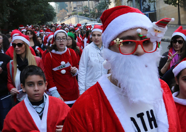 Students dressed up as Santa Claus take part in a Christmas parade in Beirut, Lebanon, December 22, 2015. (Photo by Aziz Taher/Reuters)