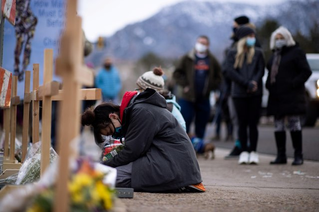 King Soopers employee Starr Samkus, 20, cries at the site of a mass shooting at King Soopers grocery store in Boulder, Colorado, March 23, 2021. Samkus was not working when the shooting occurred. (Photo by Alyson McClaran/Reuters)