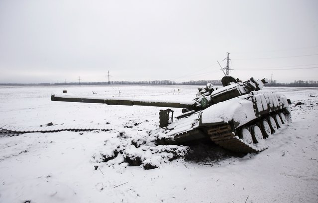 A tank of the separatist self-proclaimed Donetsk People's Republic, which was damaged during battles with the Ukrainian armed forces, is seen outside Vuhlehirsk, eastern Ukraine February 10, 2015. (Photo by Maxim Shemetov/Reuters)