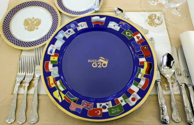 A dinner setting for G-20 leaders is placed on a table prior to a dinner at the Konstantin Palace in St. Petersburg, Russia on Thursday, September 5, 2013. The threat of missiles over the Mediterranean is weighing on world leaders meeting on the shores of the Baltic this week, and eclipsing economic battles that usually dominate when the G-20 world economies meet. (Photo by Sergei Karpukhin/AP Photo)