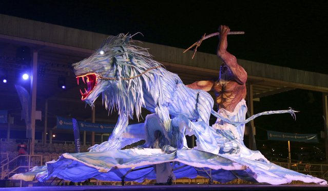 "Wade Madray portraying ""I Orgi Tou Poseidona (The Wrath Of Poseidon)"" performs at the King of Carnival show put on by the National Carnival Commission at the Queen's Park Savannah, Port-of-Spain, on February 13, 2015. (Photo by Andrea De Silva/Reuters)"