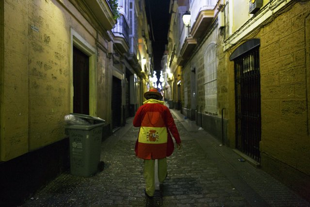 A man in fancy costume walks on a street during the Carnival of Cadiz, southern Spain February 16, 2015. (Photo by Marcelo del Pozo/Reuters)