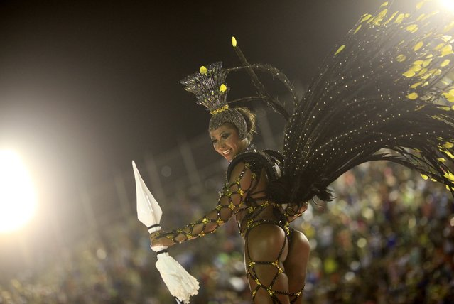 A reveler from the Sao Clemente samba school participates in the annual carnival parade in Rio de Janeiro's Sambadrome, February 16, 2015. (Photo by Ricardo Moraes/Reuters)