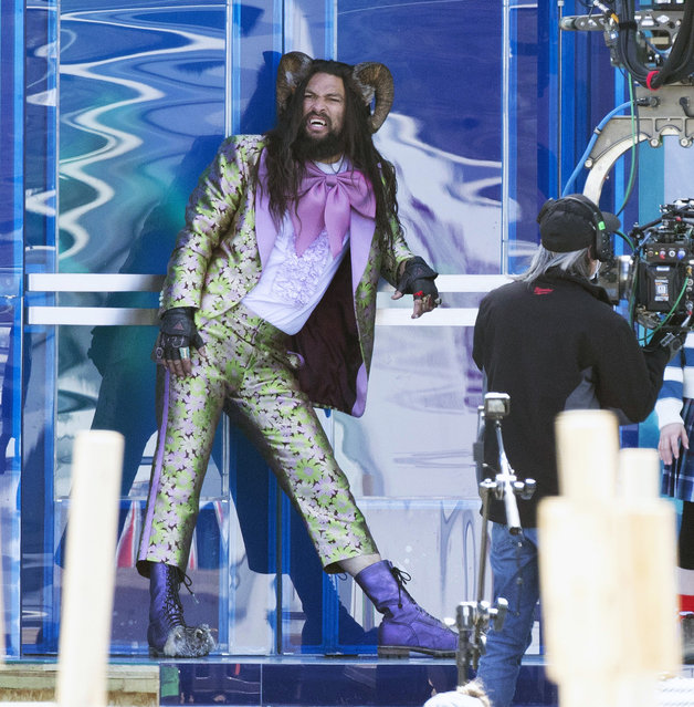 "American actor Jason Momoa and co-star Marlow Barkley Spotted filming ""Slumberland"" in Toronto, Canada on April 26, 2021. Momoa was in costume wearing his horns, a flashy silk suit with a giant pink bowtie. (Photo by TheImageDirect)"