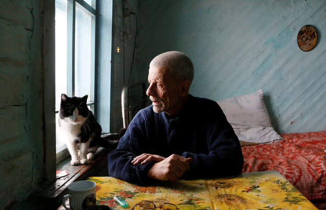 Mikhail Baburin, 66, talks to his cat Marquis at his house in the remote Siberian village of Mikhailovka, Krasnoyarsk region, Russia, December 5, 2016. (Photo by Ilya Naymushin/Reuters)