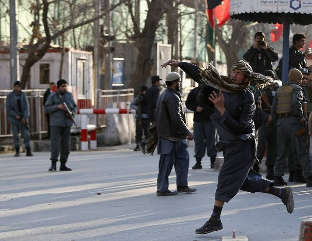 An Afghan man throws a stone towards a U.S. compound during a demonstration against the satirical French weekly Charlie Hebdo's cartoons of the Prophet Mohammad, in Kabul, January 23, 2015. (Photo by Omar Sobhani/Reuters)