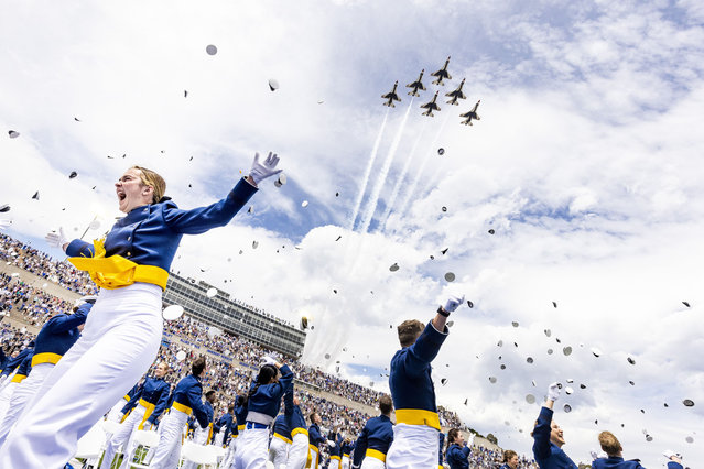 United States Air Force Academy graduates cheer as the United States Air Force Thunderbirds fly over the graduation for the Class of 2021 at Falcon Stadium on May 26, 2021 in Colorado Springs, Colorado. Chairman of the Joint Chiefs of Staff General Mark A. Milley gave the commencement address to the 1,019 graduates from the academy. (Photo by Michael Ciaglo/Getty Images)