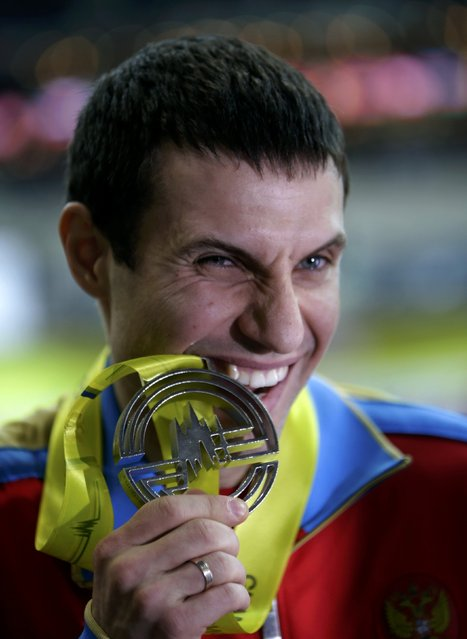 Second placed Aleksandr Gripich of Russia celebrates on the podium at the medal ceremony for the men's pole vault final during the European Indoor Championships in Prague March 8, 2015. REUTERS/David W Cerny (CZECH REPUBLIC  - Tags: SPORT ATHLETICS)