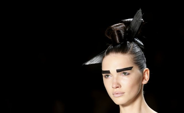 A models sports a special hairstyle as she presents a collection by Irene Luft at the Berlin Fashion Week Autumn/Winter 2016 in Berlin, Germany, January 22, 2016. (Photo by Fabrizio Bensch/Reuters)