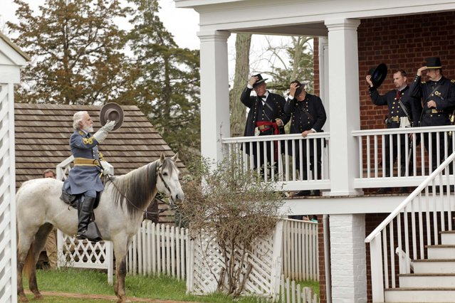Period-costumed actor of General Robert E. Lee leaves after the surrender during the 150th anniversary re-enactment of the surrender of General Robert E. Lee to General Ulysses S. Grant at the Museum of Confederacy in Appomattox, Virginia,  April 9, 2015. (Photo by Jay Paul/Reuters)