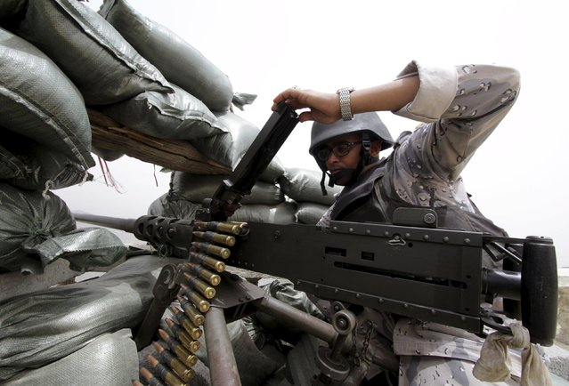 A Saudi soldier loads ammunition at their position at Saudi Arabia's border with Yemen April 6, 2015. (Photo by Faisal Al Nasser/Reuters)