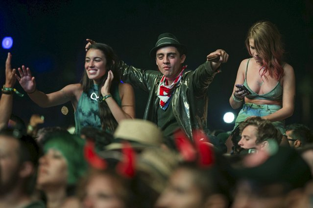 People react while listening to AC/DC's performance at the Coachella Valley Music and Arts Festival in Indio, California April 10, 2015. (Photo by Lucy Nicholson/Reuters)