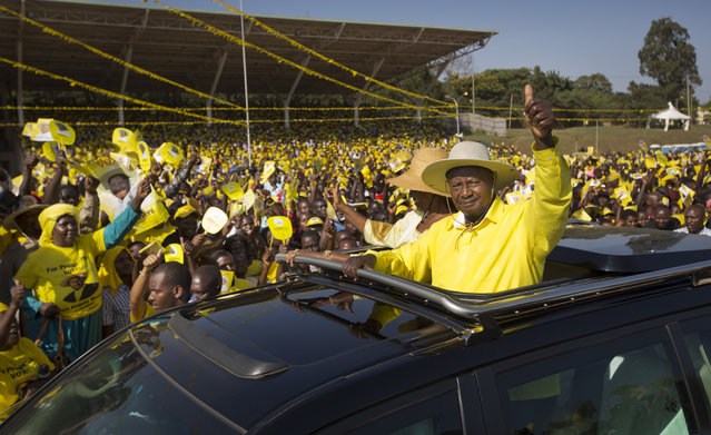 In this Tuesday, February 16, 2016 file photo, Uganda's long-time President Yoweri Museveni waves to supporters from the sunroof of his vehicle as he arrives for an election rally at Kololo Airstrip in Kampala, Uganda. Uganda election commission declared on Saturday, Feb. 20, 2016 President Yoweri Museveni the winner of elections, with more than 60 percent of vote. (Photo by Ben Curtis/AP Photo)