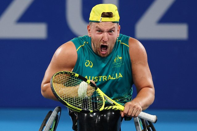 Dylan Alcott of Australia celebrates winning his match against Niels Vink of the Netherlands in wheelchair tennis quad singles semifinals at Ariake Tennis Park in Tokyo, Japan on August 31, 2021. (Photo by Thomas Peter/Reuters)