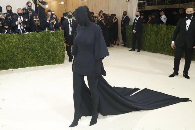 """US socialite Kim Kardashian arrives for the 2021 Met Gala at the Metropolitan Museum of Art on September 13, 2021 in New York. This year's Met Gala has a distinctively youthful imprint, hosted by singer Billie Eilish, actor Timothee Chalamet, poet Amanda Gorman and tennis star Naomi Osaka, none of them older than 25. The 2021 theme is """"In America: A Lexicon of Fashion"""". (Photo by Mario Anzuoni/Reuters)"""