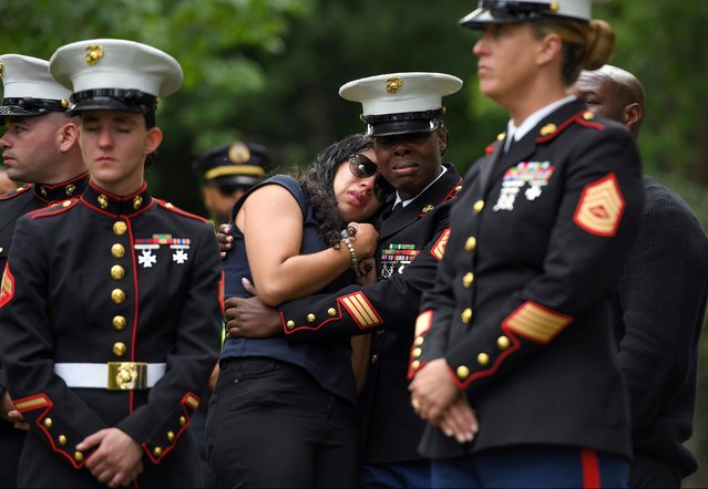 Fellow Marines who served in Bahrain with Marine Corps Sgt. Johanny Rosario Pichardo, who was among 13 U.S. service members killed in the airport suicide bombing in Afghanistan's capital Kabul, pay their respects in her hometown in Lawrence, Massachusetts, U.S., September 14, 2021. (Photo by Faith Ninivaggi/Reuters)