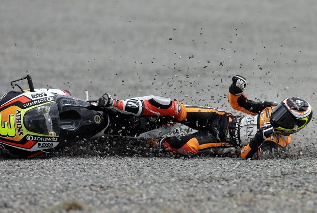 Italy's Simone Corsi crashes his Forward Kalex  during the Moto2 race of the Argentina's Motorcycle Grand Prix at the Termas de Rio Hondo circuit in Argentina,  Sunday, April 19, 2015. (Photo by Natacha Pisarenko/AP Photo)