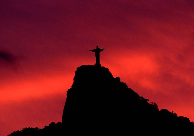 The statue of Christ the Redeemer is seen at sunset on November 2, 2010. (Photo by Felipe Dana/Associated Press)