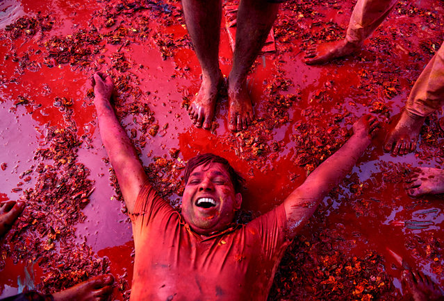 A Hindu devotee seen lying on the ground of Radharani Temple after completion of Holi celebration at Nandgaon, Uttar Pradesh, India on March 16, 2019. Holi Festival of India is one of the biggest Holi celebration in India as many Tourists and devotees gather to observe this colourful programme. (Photo by Avishek Das/SOPA Images/LightRocket via Getty Images)