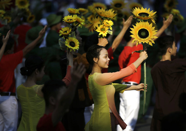 Dancers perform during a parade celebrating the 40th anniversary of the end of the Vietnam War which is also remembered as the fall of Saigon, in Ho Chi Minh City, Vietnam, Thursday, April 30, 2015. (Photo by Dita Alangkara/AP Photo)