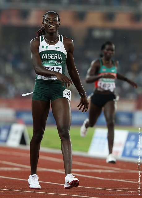 Muizat Odumosu of Nigeria smiles after winning the women's 400 metres hurdles final at Jawaharlal Nehru Stadium during day seven of the Delhi 2010 Commonwealth Games on October 10, 2010 in Delhi, India
