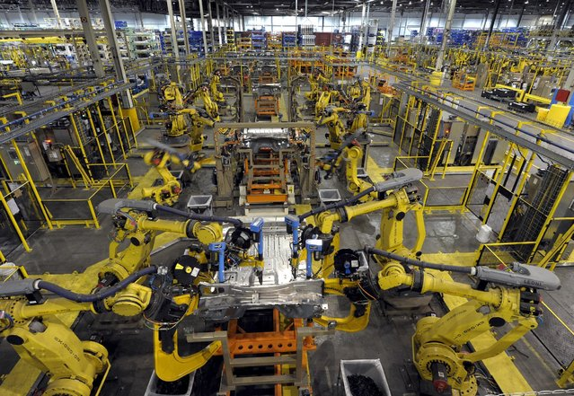 Robotic arms rivet floor panels together at Ford's Kansas City Assembly Plant where the new aluminum intensive Ford F-Series pickups are built in Claycomo, Missouri May 5, 2015. (Photo by Dave Kaup/Reuters)
