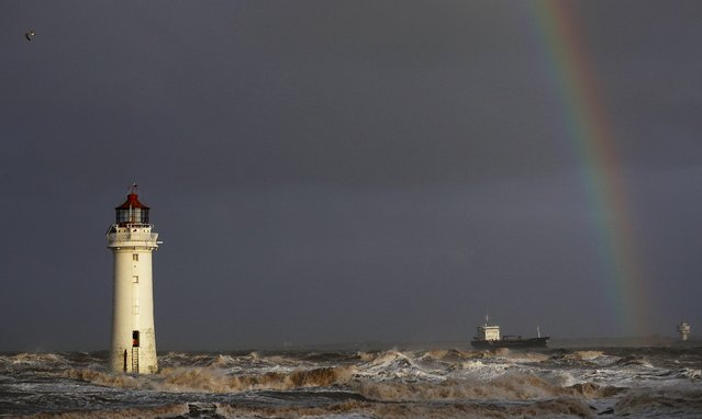 A tanker battles through heavy seas as it passes Perch Rock lighthouse on the River Mersey at New Brighton, northern England January 11, 2017. (Photo by Phil Noble/Reuters)