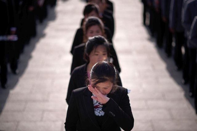 "A woman wiper her eyes as she waits to pay her respects before the statues of late North Korean leaders Kim Il Sung and Kim Jong Il, as part of celebrations marking the anniversary of the birth of Kim Il Sung, known as the ""Day of the Sun"", on Mansu hill in Pyongyang on April 15, 2019. (Photo by Ed Jones/AFP Photo)"