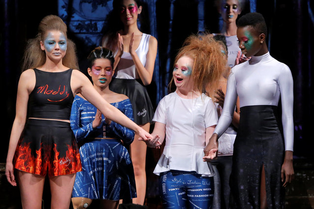 Australian model and designer Madeline Stuart, who has Down syndrome, acknowledges attendees after presenting creations from her label 21 Reasons Why By Madeline Stuart during New York Fashion Week in Manhattan, New York, U.S., February 12, 2017. (Photo by Andrew Kelly/Reuters)