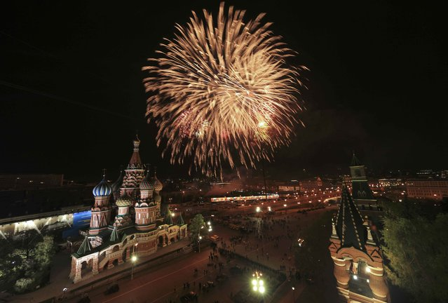 Fireworks explode over St. Basil's Cathedral during the Victory Day celebrations at Red Square in Moscow, Russia, May 9, 2015. (Photo by Reuters/Host Photo Agency/RIA Novosti)