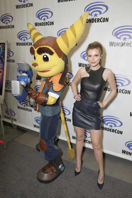 """Ratchet and Bella Thorne seen at Gramercy Pictures """"Ratchet & Clank"""" Wondercon Presentation at Los Angeles Convention Center on Friday, March 25, 2016, in Los Angeles, CA. (Photo by Eric Charbonneau/Invision for Focus Features/AP Images)"""