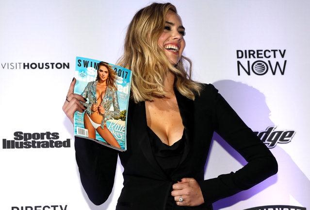 Model Kate Upton poses with copies of the 2017 Sports Illustrated Swimsuit Issue at a launch event for the  Swimsuit Issue in New York City, U.S., February 16, 2017. (Photo by Mike Segar/Reuters)