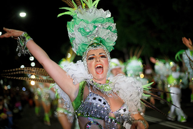 A member of 'Los Cariocas' troupe performs in the troupes dancing contest during the Santa Cruz de Tenerife Carnival on March 1, 2014 in Santa Cruz de Tenerife on the Canary island of Tenerife, Spain. (Photo by Pablo Blazquez Dominguez/Getty Images)