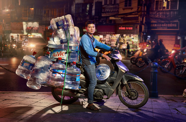 "Water for office workers. ""There is such a skill to loading up a motorbike to this level, and knowing what your limits are, and then on top of that, getting to your destination with a full undamaged load"". (Photo by Jon Enoch/The Guardian)"