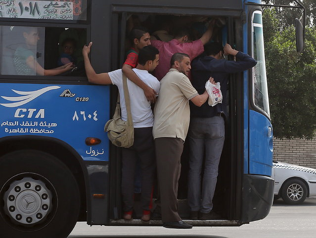 A public bus crammed with commuters is seen on the outskirts of Cairo, Egypt May 10, 2015. (Photo by Asmaa Waguih/Reuters)