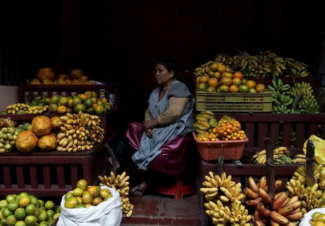 A woman sits at a fruit stall at a market in Villa Tunari in the Chapare region, Bolivia, May 17, 2019. (Photo by David Mercado/Reuters)