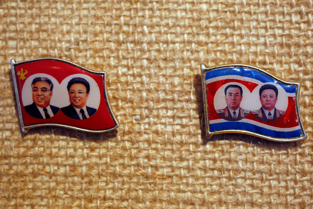Two pins featuring former North Korean leader Kim Il Sung and Kim Jong Il in suits and military uniform are displayed in a glass case of Thomas Hui at his apartment in Hong Kong, China April 11, 2016. (Photo by Bobby Yip/Reuters)