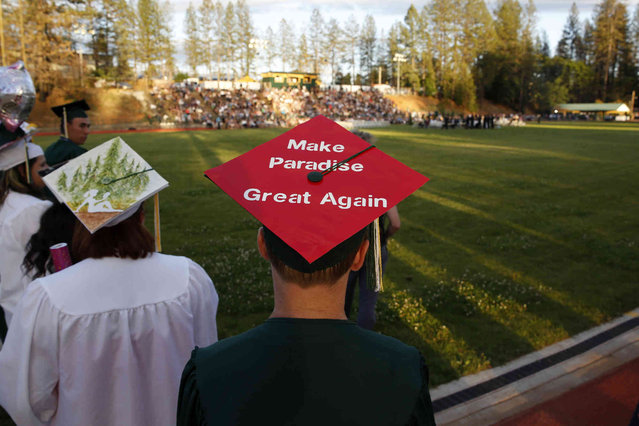 Ryan Chandler wear a simple message on his graduation cap to the graduation ceremonies at Paradise High School in Paradise, Calif., Thursday June 6, 2019. Most of the students of Paradise High lost their homes when the Camp Fire swept through the area and the school was forced to hold classes in Chico. The seniors gathered one more time at Paradise High for graduation ceremonies. (Photo by Rich Pedroncelli/AP Photo)