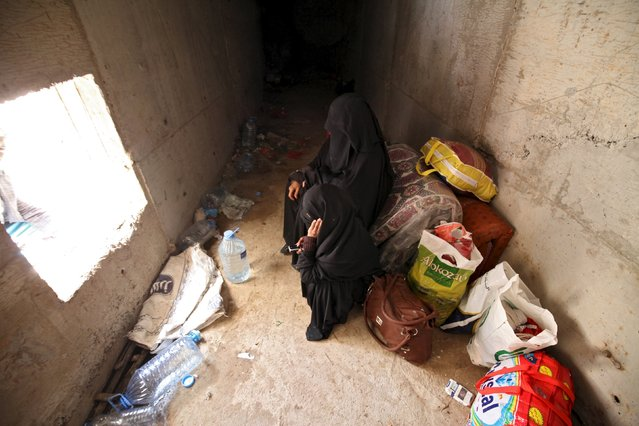 Women rest in an underground water tunnel with other displaced people (not pictured) after they were forced to flee their home due to ongoing air-strikes carried out by the Saudi-led coalition in Sanaa May 2, 2015. (Photo by Mohamed al-Sayaghi/Reuters)