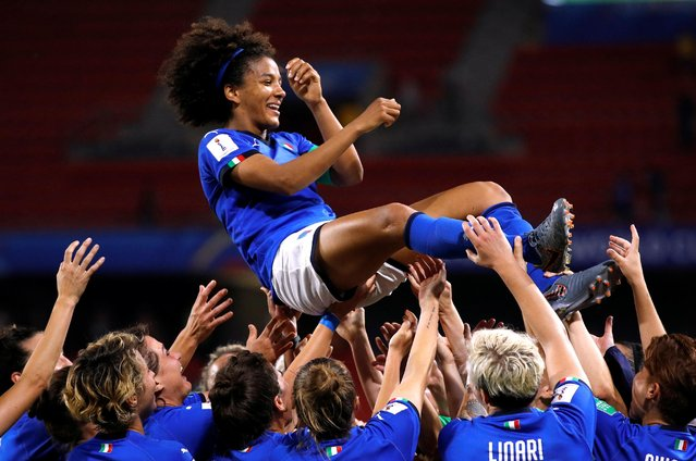 Italy's Sara Gama, top, celebrates with teammates at the end of the Women's World Cup Group C soccer match between Italy and Brazil at the Stade du Hainaut in Valenciennes, France, Tuesday, June 18, 2019. Italy won Group C on goal difference over Australia and Brazil as all three nations finished with 2-1 records and six points. Le Azzurre will play a third-place team in the round of 16 on Tuesday. (Photo by Phil Noble/Reuters)