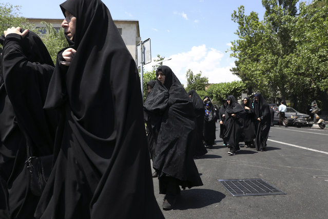 In this Friday, May 17, 2019 photo, worshippers leave at the conclusion of the Friday prayers in downtown Tehran, Iran. (Photo by Vahid Salemi/AP Photo)