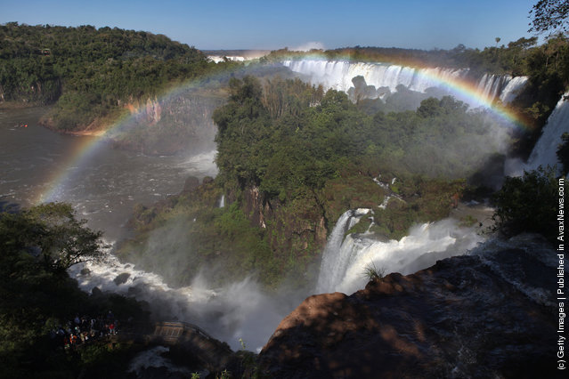 The rainbow which frames San Martin Island is formed by mist rising from the Iguacu Falls in the Iguazu National Park