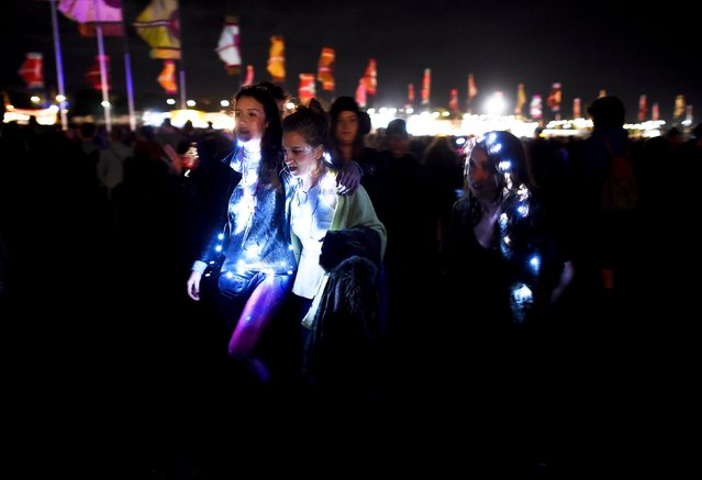 Revellers are lit up as they walk through Worthy Farm in Somerset during the Glastonbury Festival in Britain, June 27, 2015. (Photo by Dylan Martinez/Reuters)