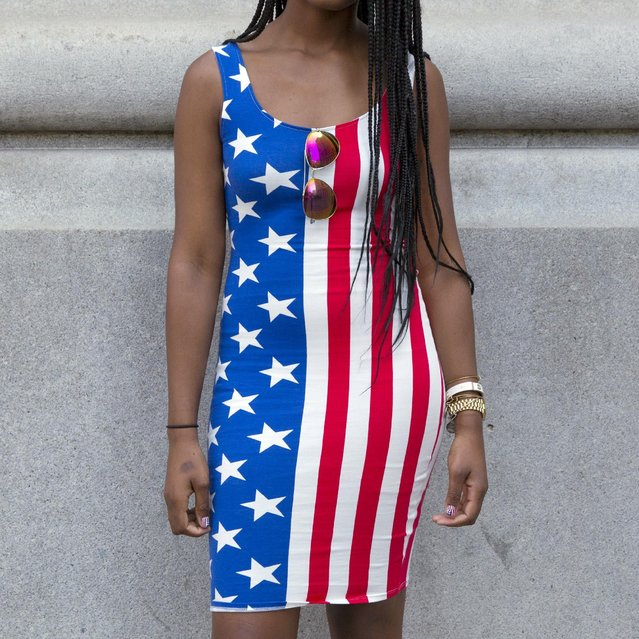 A girl wears a dress with the design of the U.S. flag in Manhattan, New York, July 3, 2015, ahead of the Fourth of July holiday. The U.S. celebrates its Independence Day on July 4. (Photo by Andrew Kelly/Reuters)