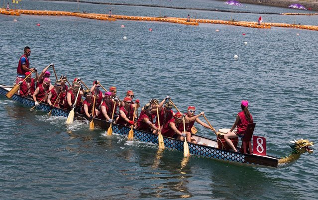 Dragon boat racers prepare for the fancy dress race on July 5, 2015 in Hong Kong, Hong Kong. (Photo by Taylor Weidman/Getty Images for Hong Kong Images)