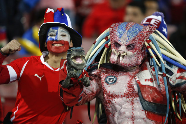 Chile's fans pose during a Copa America semifinal soccer match between Chile and Peru at the National Stadium in Santiago, Chile, Monday, June 29, 2015. (Photo by Andre Penner/AP Photo)