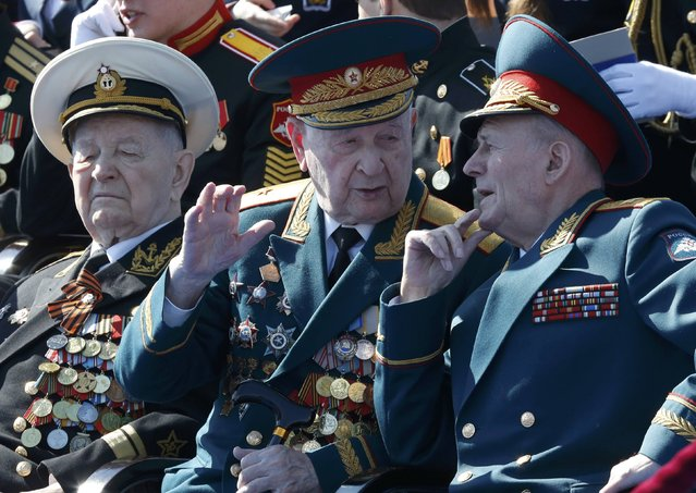 World War Two veterans wait before watching the Victory Day parade, marking the 71st anniversary of the victory over Nazi Germany in World War Two, at Red Square in Moscow, Russia, May 9, 2016. (Photo by Grigory Dukor/Reuters)