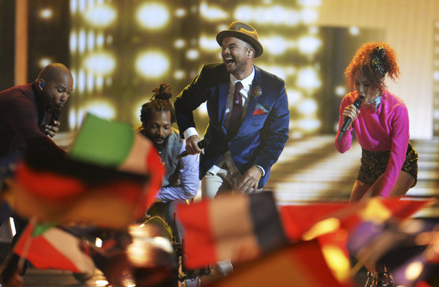 """In this Saturday, May 23, 2015 file photo, Guy Sebastian representing Australia performs the song """"Tonight Again"""" during the final of the Eurovision Song Contest in Austria's capital Vienna. His performance was the first by an Australian in the annual contest. (Photo by Kerstin Joensson/AP Photo)"""