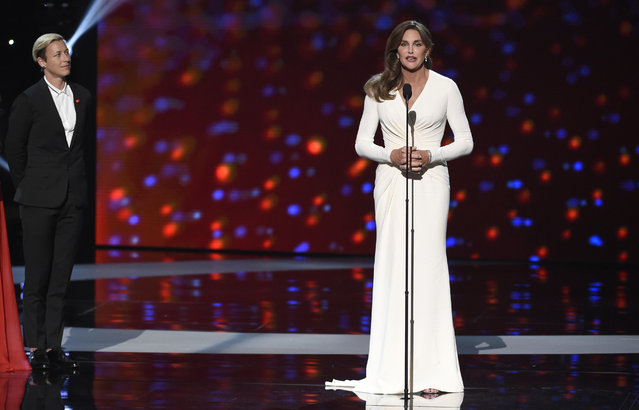 Soccer player Abby Wambach, of the United States women's national soccer team, left, looks on as Caitlyn Jenner accepts the Arthur Ashe award for courage at the ESPY Awards at the Microsoft Theater on Wednesday, July 15, 2015, in Los Angeles. (Photo by Chris Pizzello/Invision/AP Photo)